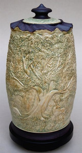"Tree of Life Prayer Wheel CONTACT CHRIS MOENCH FOR AVAILABILITY  Deeply carved intricate bass relief imagery in porcelain with celadon glaze. 18' X 10"", $2,100"