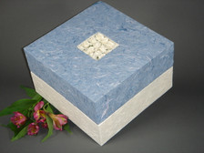 Floral Bouquet - this Embrace biodegradable paper urn features handmade paper flowers inset into the decorative blue top.