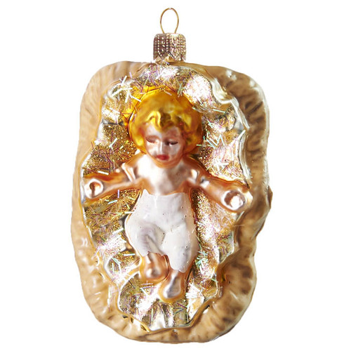 The essence of Christmas is elegantly captured in our annual nativity design. Skillfully crafted in the Czech Republic, the timeless baby Jesus in a crib made of mouth-blown glass. Hand decorated.