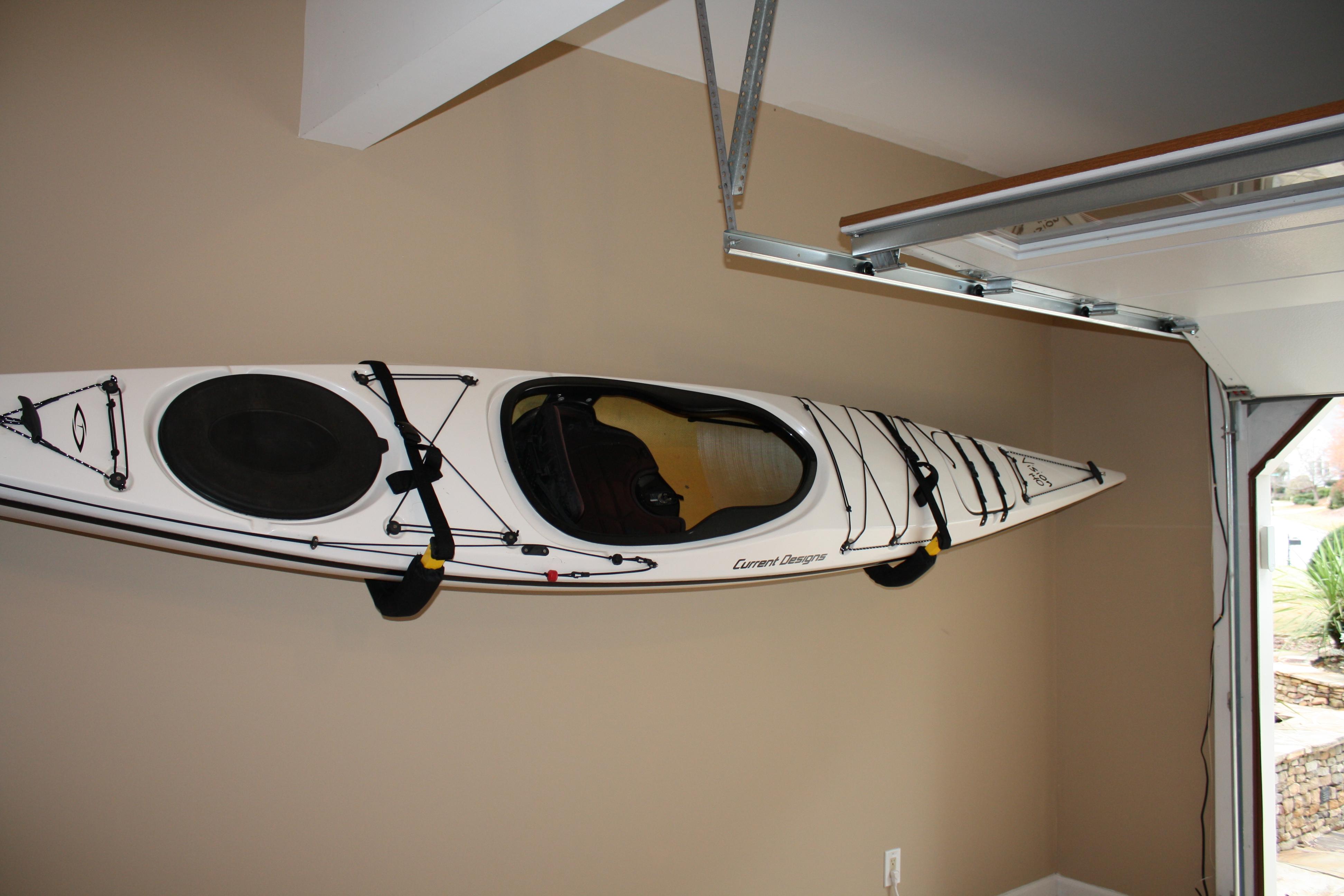 ideas for storing kayaks in garage - Padded Kayak Wall Rack