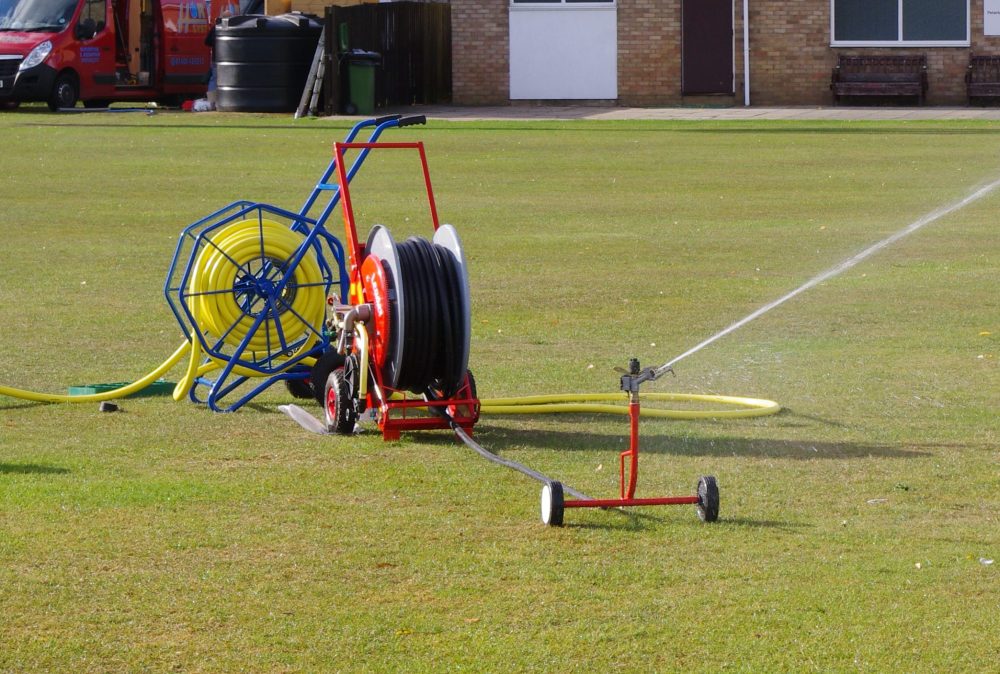 Hosereel irrigator cricket square pitch watering system