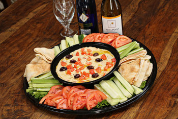A family recipe made with the freshest and most authentic ingredients, topped with olives and Extra Virgin Olive Oil, surrounded with celery sticks, sliced cucumber, apple wedges and served with pita triangles. A popular choice for any size gathering!