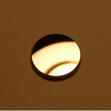 Aluminized front surface mirror, 17 mm diameter.