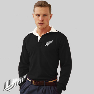 This New Zealand rugby shirt is for all you All Blacks supporters. Vintage black rugby shirt with white contrast collar. The shirt has been embroidered with the classic silver fern crest.