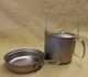 Here's the 1400 with the titanium lid on the pot. Get two titanium lids, and you'll have lids for both the pan and pot!