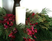Stunning Christmas decorations...evergreens and Eco-friendly red rose petals. Candles not included