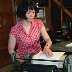 yoshiko-yamamoto-working-at-the-press