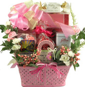 Pink Planter filled with truffles, silk flowers, taffy, toffee, chocolate hearts.