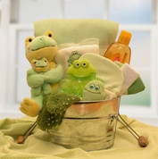 Wash Bin filled with plush green frogs, wash cloths, baby clothes, shampoo and more.