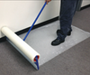 "Zip-Up Carpet protection film from www.leadPaintEPAsupplies.com, The Renovators Supply Store.  24"" x 200' Peel and stick adhesive technology being placed with optional applicator."
