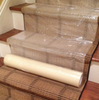 "Zip-Up Carpet protection film from www.leadPaintEPAsupplies.com, The Renovators Supply Store.  24"" x 200' Peel and stick adhesive technology being placed on steps."