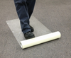 "Zip-Up Carpet protection film from www.leadPaintEPAsupplies.com, The Renovators Supply Store.  36"" x 200' Peel and stick adhesive technology being placed without optional applicator."