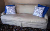 Separate Seat t-cushion slipcover with accent pillows.