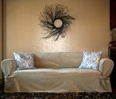 Tie arm slipcover in dessert sand velvet with accent pillows.