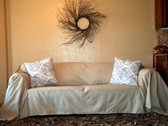 Dropcloth slipcover in parchment twill with accent pillows.