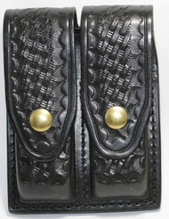 Gould & Goodrich Leather Basketweave Magazine Pouch holds (2) double stack magazines. This pouch has brass snaps.