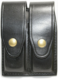 Gould & Goodrich Leather Magazine Pouch holds (2) wide double stack magazines. This pouch has brass snaps.