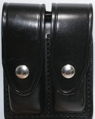Gould & Goodrich Leather Magazine Pouch holds (2) wide double stack magazines. This pouch has nickel snaps.