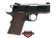 This is a 1911 Colt Defender chambered in .45 acp, officers model. This model has G10 black cherry grips and comes with (2) 7 round magazines.