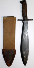 """original WWI US Model 1917 bolo knife that is maker marked """"PLUMB PHILA."""" on the left side of the blade and dated 1918. Right side of blade is marked """"U.S. MOD. 1917"""".  Wood grips have original finish and a good tight fit. Fitted in correct original scabbard where the Canvas shows wear and staining. Leather tip is dry. A nice example of a classic WWI US Model 1917 bolo knife for your collection."""