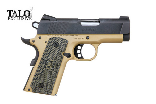 This is a 1911 Colt Defender chambered in .45 acp, defender model. This model has G10 thin green grips and comes with (2) 7 round magazines.