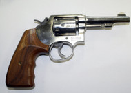 This is a Smith & Wesson 10-7, .38 special revolver, USED.   With a bright stainless finish