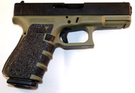 Glock 23 used chambered in 40 S&W with a OD Green frame w/ grip tape