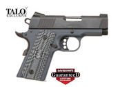 This is a 1911 Colt Defender chambered in 9mm, defender model. This firearm has a Combat Grey cerakote finish and G10 grips.