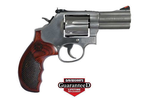 Smith & Wesson M686 Plus chambered in 357 magnum. Stainless steel finish with checkered hardwood grips
