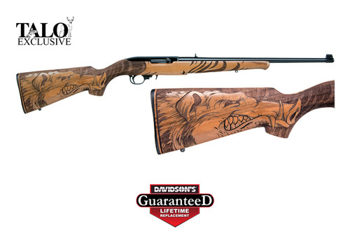 This is a 10/22 chambered in 22 long rifle, Manufactured by Ruger. This Talo special edition has a Wild Hog engraved into the Walnut stock.