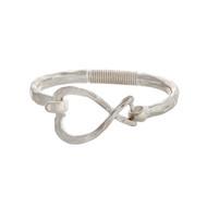 Worn silver tone latch bangle bracelet with an open heart
