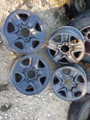 Four (4) OEM tundra 18x8 steel wheels painted graphite mica