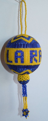 L A Rams team ball with blue letters.