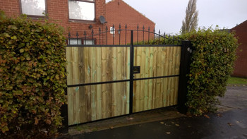 Metal framed wood gates