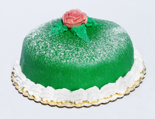 "This delicate Swedish torte is handcrafted in our bakery and is made with the finest ingredients that include moist white cake, raspberry preserve, rich vanilla Bavarian cream and whip cream. This special torte is then wrapped with green marzipan and dusted with powdered sugar on top. 8"" Round - $23.00 – Serves 8-10 people"