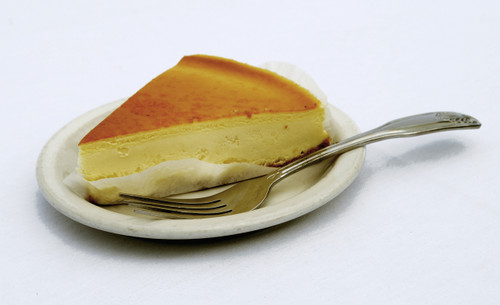 New York Cheesecake is an American tradition made with fresh lemon, vanilla, a thin layer of graham cracker crust and then topped with decadent cream cheese. This cake goes perfect with a cup coffee!