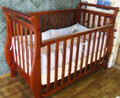Teak sleight baby cot