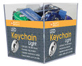 Cube of 48 Keychain LED Lights accessory. General Merchandise. Hal Leonard #8071A48. Published by Hal Leonard.  These handy keychains feature bright white, energy-efficient LED lights. There is a press-on switch or a constant-on switch option. Beam visible up to one mile away! Powered by two included lithium batteries.