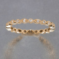 Eternity Rose Gold Band with Alternating Diamond Bezels