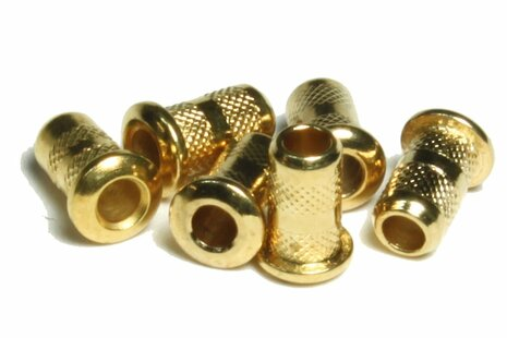 Smaller gold plated through body top mounting guitar string ferrules.