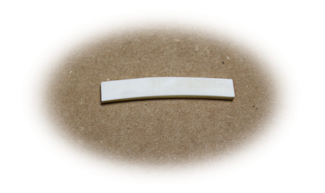 Preshaped bone nut for Fender guitars with curved bottom.  Unslotted