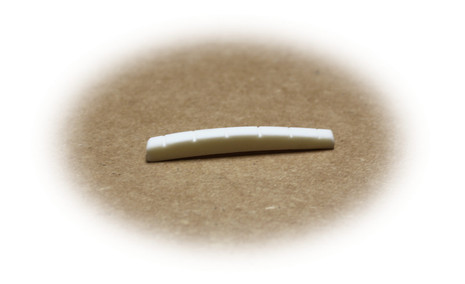 Preshaped bone nut for Fender guitars with curved bottom and slotted.