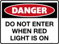 DANGER - DO NOT ENTER WHEN RED LIGHT IS ON
