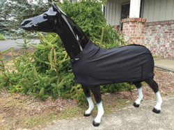 Miniature fleece stretch sheets by Sleazy Sleepwear for Horses can be used alone or with a hood.  Sleazy Mini Sheets are made of polyester and spandex.  All Sheets are reinforced along the back to prevent over-stretching and include a fleece lined adjustable neck. Sleazy Stretch Sheets have adjustable rear leg straps with snap hook closures.   The fleece sheets come in Black only.  Available in 5 sizes.  Size is determined by girth measurement in inches.     * NOTE: All Miniature Horse products made by Sleazy Sleepwear for Horses, are sewn with the seams on the outside of the garment to help keep a smooth coat.