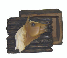 "These trinket boxes feature either a Black Horse Head or a Palomino Horse Head.  Made from a resin material these boxes are perfect for keeping all of your little treasures.  Makes a great gift for the horse lover.  Size is approx. 3' Tall x 3.75 Wide x 3"" Deep"
