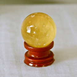 Honey Calcite is said to have Power and Healing energies and to be excellent for meditation.   Calcite Sphere - Golden Honey color.  Weight is .14 lbs or 2.24 oz., sphere is approx. 37 mm.  The Calcite Sphere pictured is the one that you will be receiving upon purchase of this item.  Stand is not included.