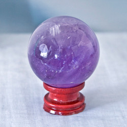 Amethyst is known for it's power, protection and healing energies.  Helps to calm emotions and promotes clarity.   Amethyst Sphere - Weight is .48 lbs or 7.68 oz., sphere is approx. 55 mm.  The Amethyst Sphere pictured is the one that you will be receiving upon purchase of this item.  Stand is not included.