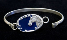 Beautiful Sterling  Silver bracelet features a horse head with a sliver of a moon and a trail of stars.  The dark blue enamel overlay gives depth.  Bracelet measures 2 inches high and 2.5 inches wide.  Also see matching pendant.
