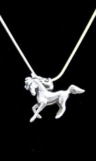 This Prancing Beauty has a beautiful flowing mane and tail and is made of Sterling Silver and comes with a 20 inch Sterling Silver snake chain. Horse pendant is 1.25 inches long and 1 inch tall.