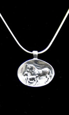 This Sterling Silver pendant has an antique heirloom feel and look.  The Mare and her Foal grace this oval shape pendant.  Comes with a 20 inch Sterling Silver Snake Chain.  Pendant is 1 inch long and 3/4 inches high.